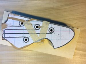 Headstock template covering a holly veneer