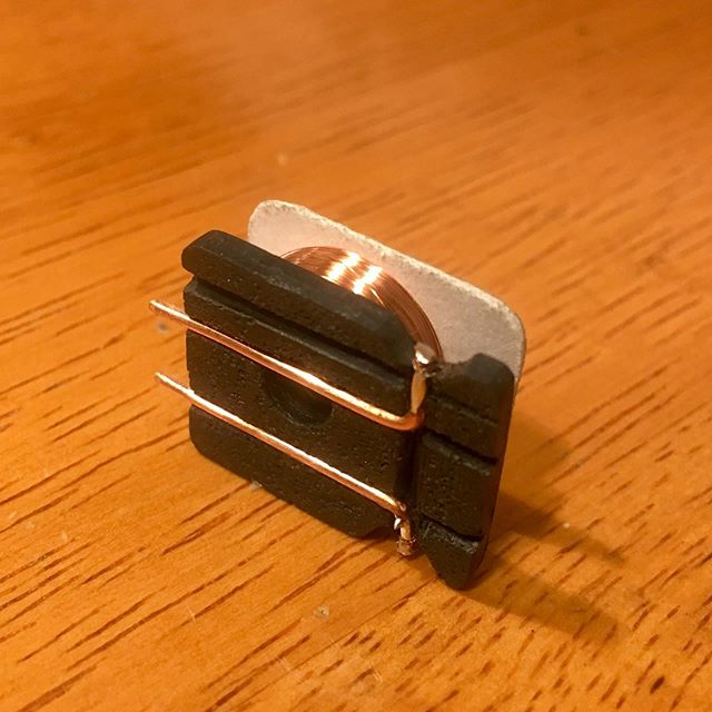 I've got this micro coil pickup project on my bench. This bobbin prototype is made of cast polyurethane and paper. I'm looking forward to getting this li'l guy up and running. #funktronicpickups #pickupwinding #handwoundpickups #basspickups #boutiqueguitars #luthiery #boutiquepickups
