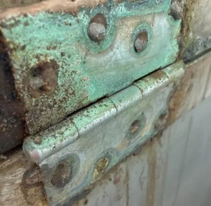 Photo taken by Dori Settles of Copper Hinges on an old kiln