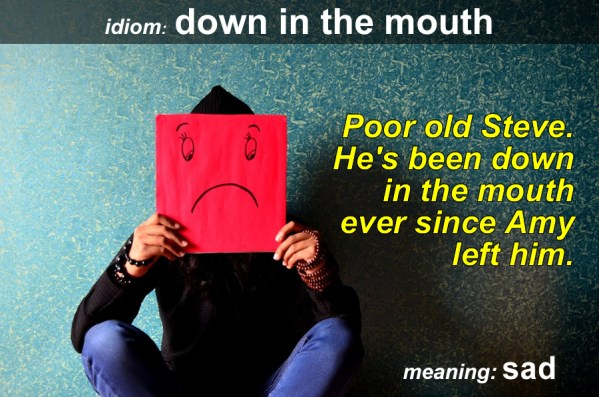 down in the mouth idiom