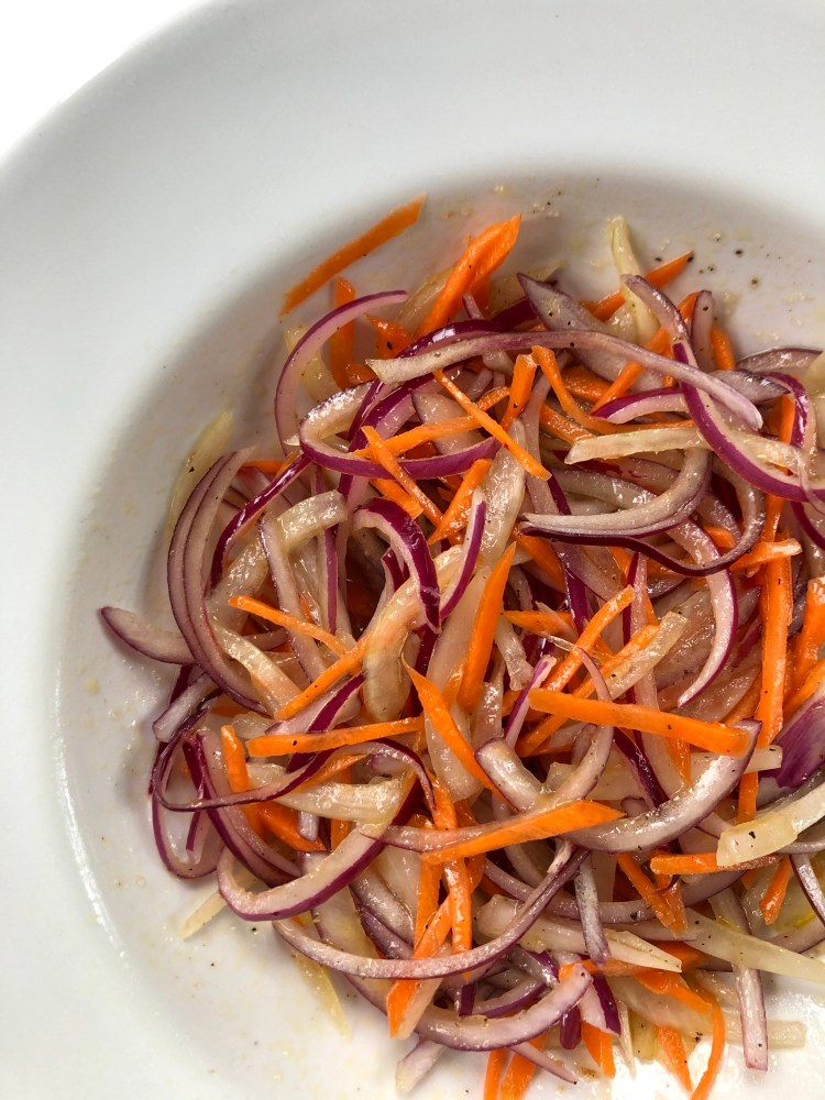 Marinated Julienned Carrot and Red Onions in a bowl