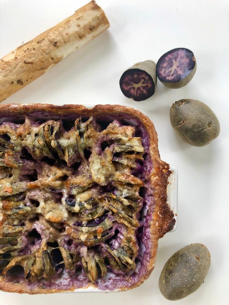 purple potato and burdock root lay next to gratin