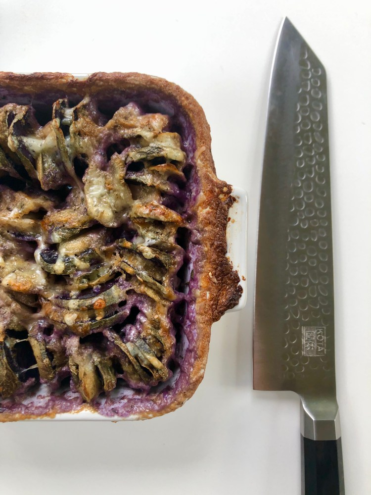 hassleback purple potato and burdock root gratin with kotai kitchen knife