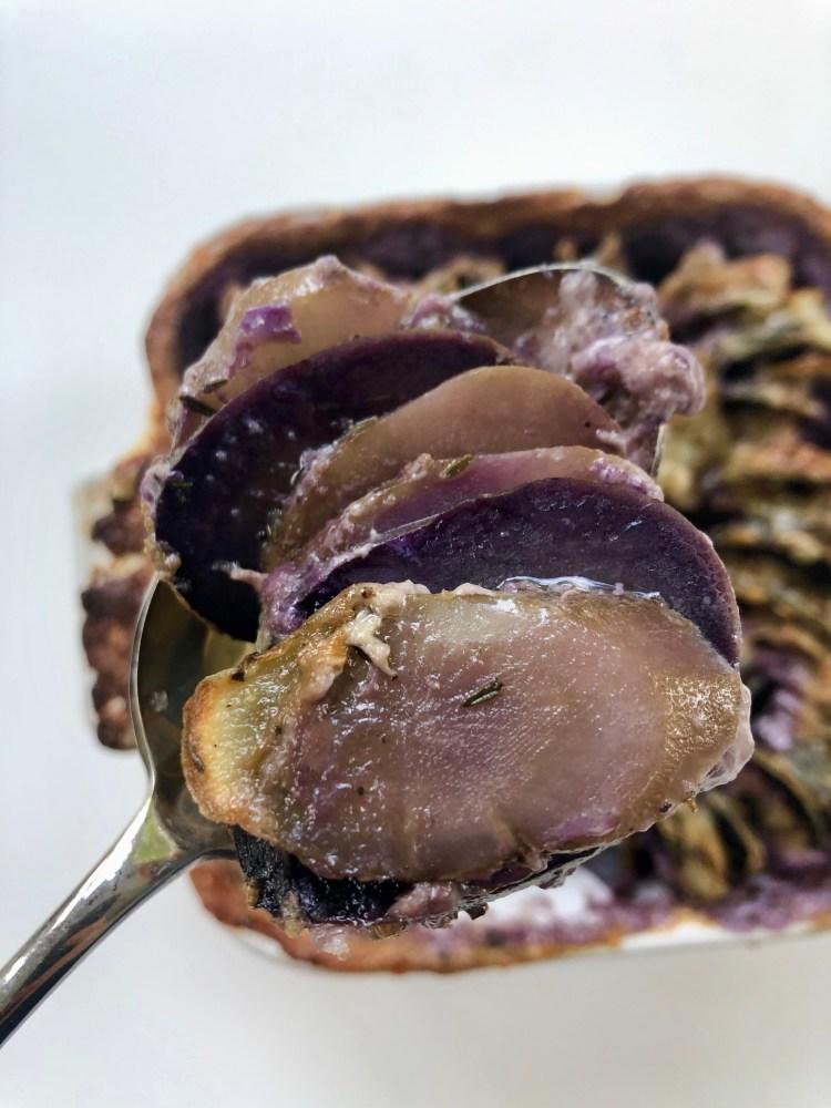 spoonful of purple potato and burdock root gratin