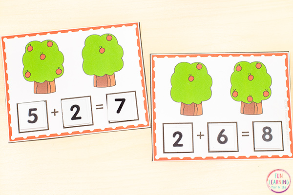 Addition cards with two apple trees on each card. Count the apples on each tree and add them together. Then create a number sentence to match.