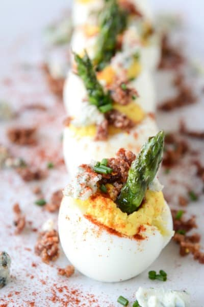 Deviled eggs with bacon and asparagus