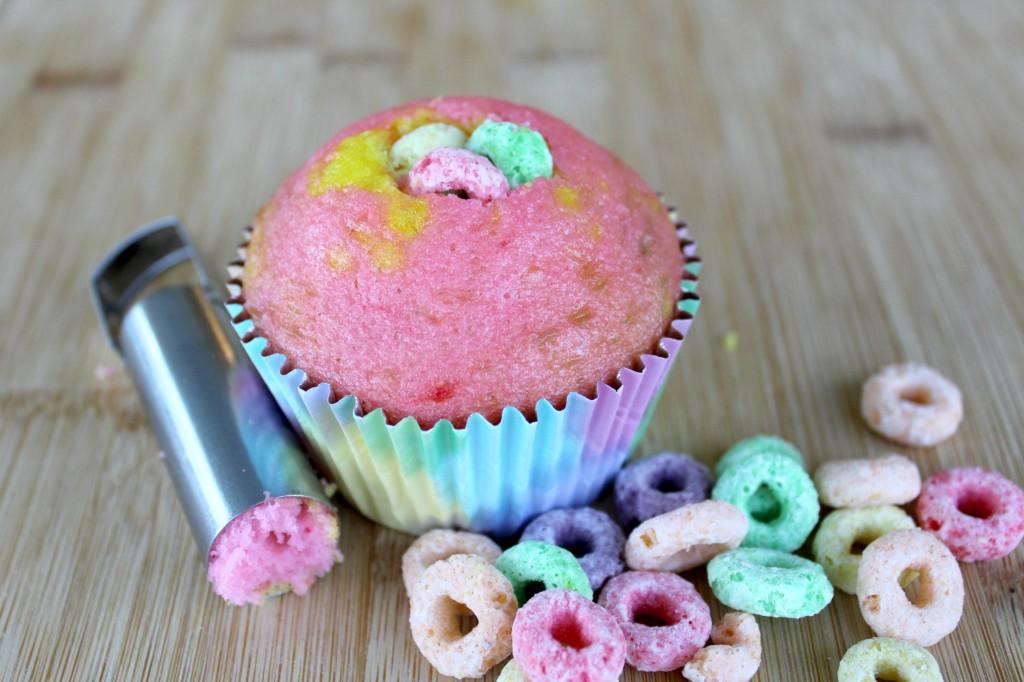 Fill the middle of the rainbow surprise cupcakes with Fruit Loops