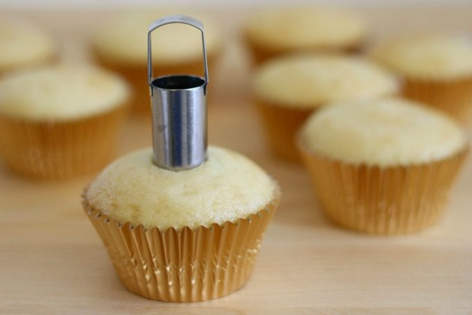 Make a hole to fill your Pirates Of The Caribbean cupcakes with treasure