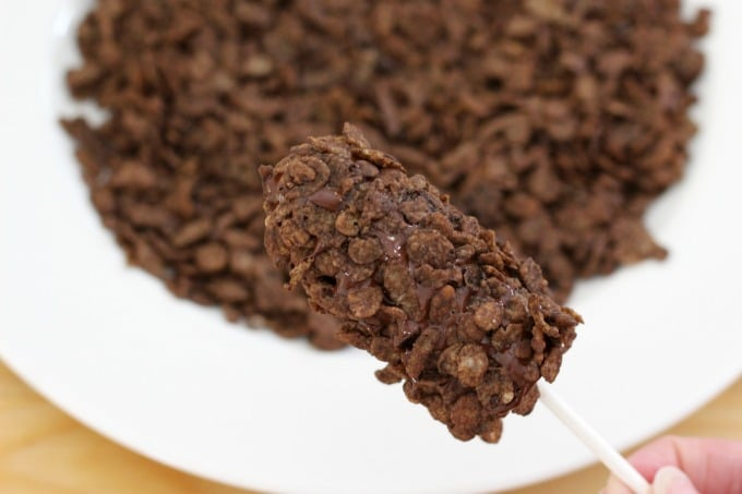 Finally, roll the banana in Cocoa Pebbles and freeze