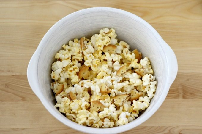 Combine crackers and popcorn in a bowl for your movie night snacks