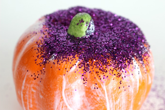 Start by covering your pumpkin with Mod Podge and sprinkling glitter over the top