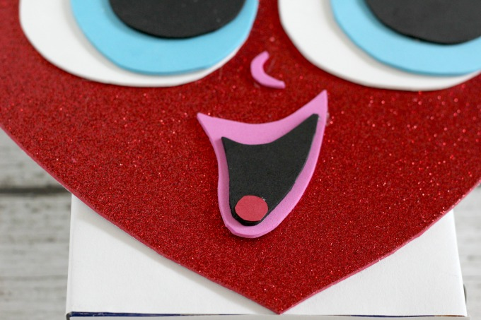 Next, give your heart shaped Valentine box a mouth