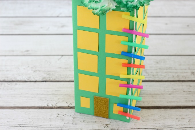 Glue the ladder to the top of the leprechaun trap.