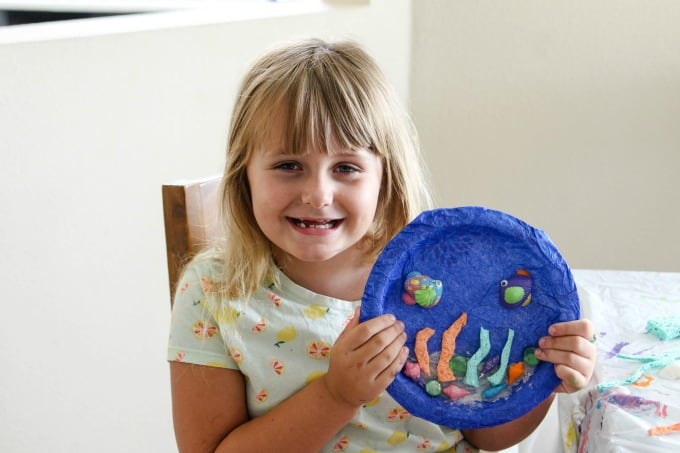 Keira with her paper plate fish craft