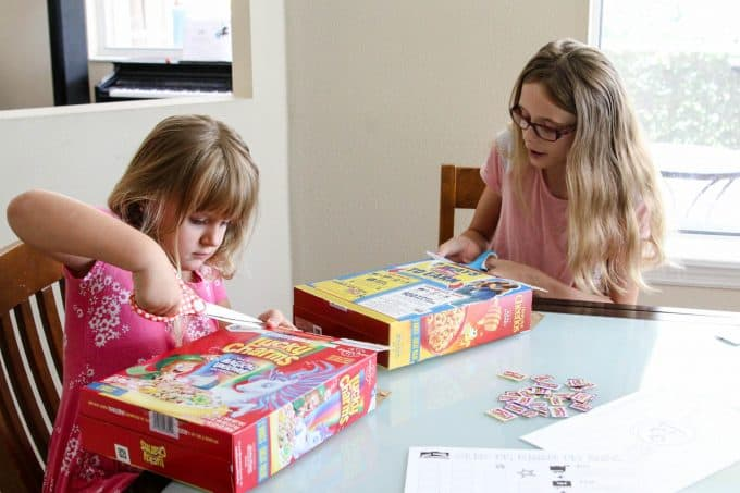 Ashling and Keira cutting out Box Tops