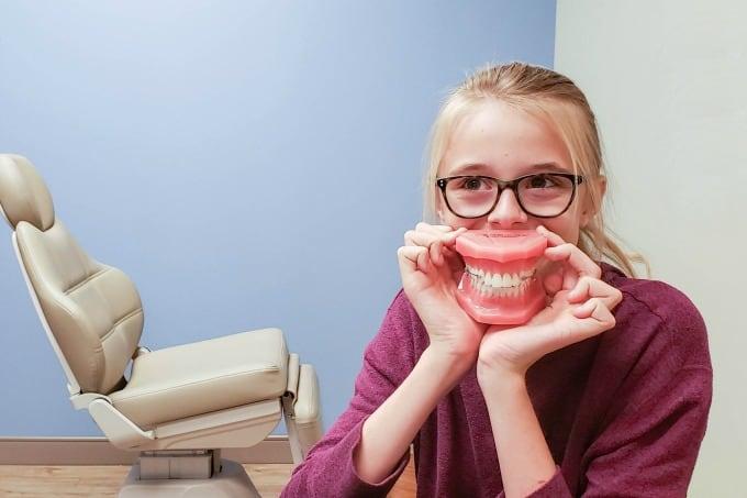 Ashling playing with fake teeth