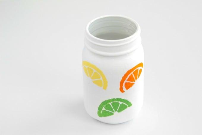 Utensil holder with citrus shapes
