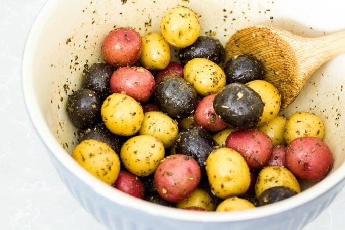 Mixing potatoes with seasoning