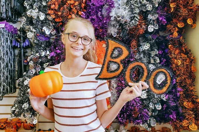 Ashling with pumpkin and boo sign