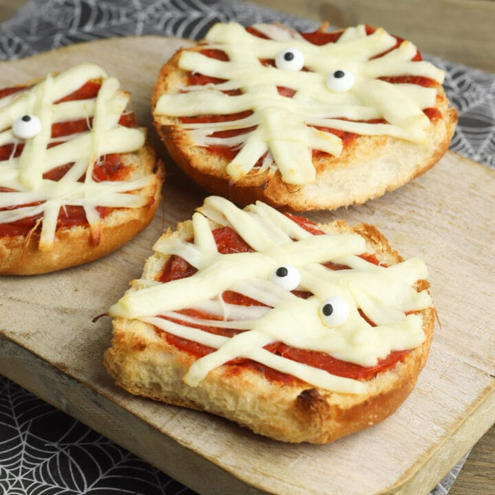 Mummy pizza on cutting board for recipe card