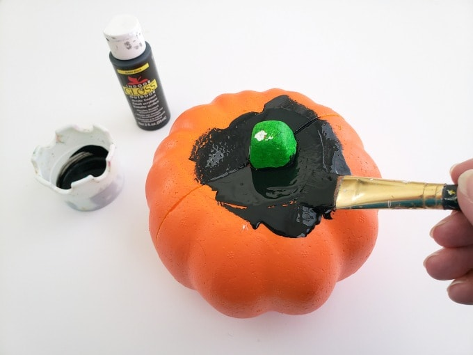 Painting pumpkin black