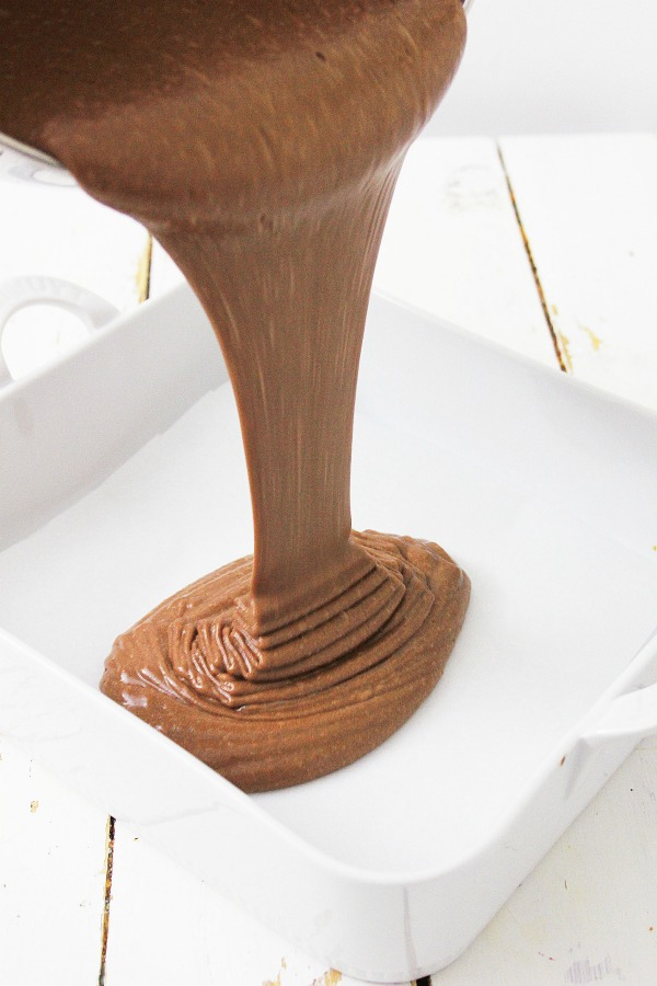 Pouring brownie batter into pan