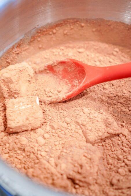 Stirring in cocoa powder