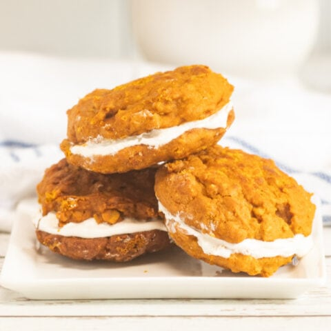 Pumpkin whoopie pies on a plate