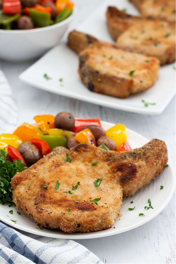Shake And Bake Pork Chops on plate and platter