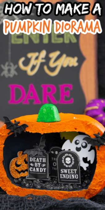 Pumpkin diorama with ghosts and bats