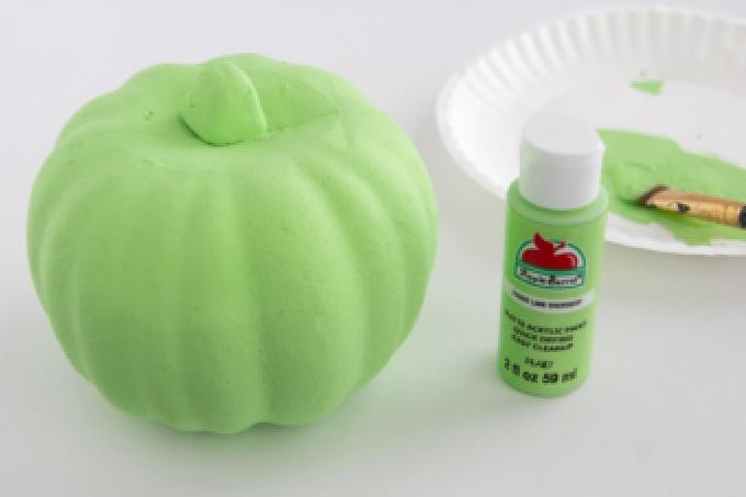 Styrofoam pumpkin painted green