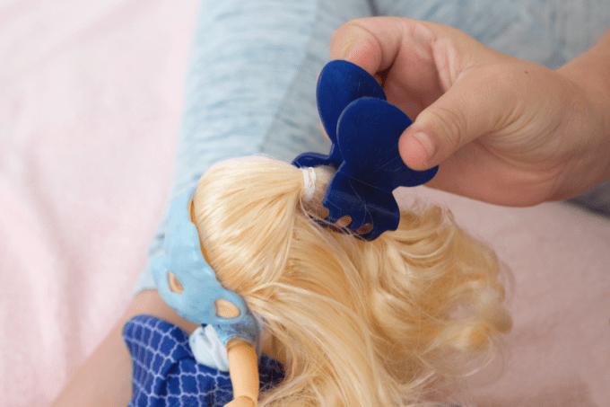 Putting butterfly clip in FailFix doll's hair