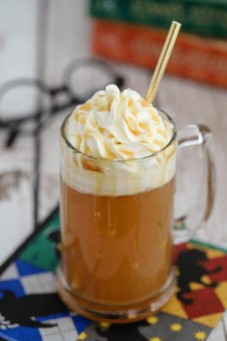 Harry Potter butterbeer in a glass with straw