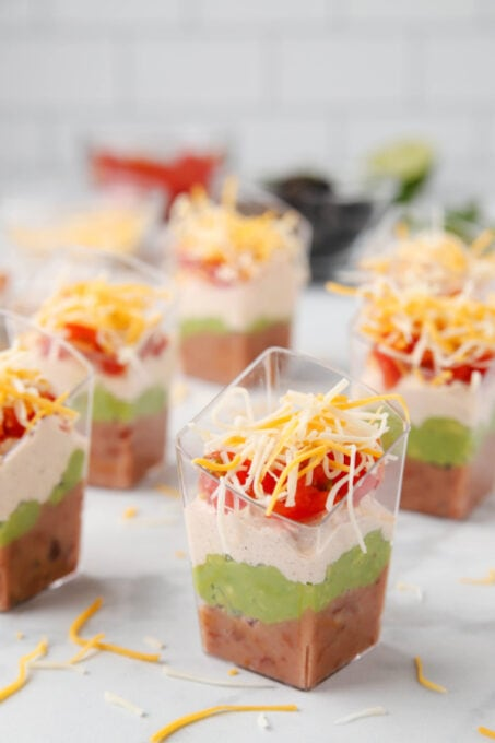 Layers of refried beans, guacamole and more