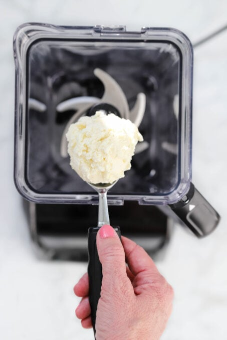 Scooping vanilla ice cream into blender