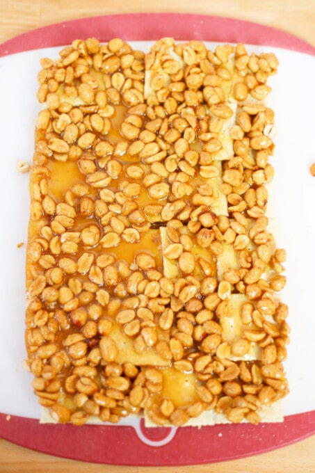 Toffee mixture poured over crackers