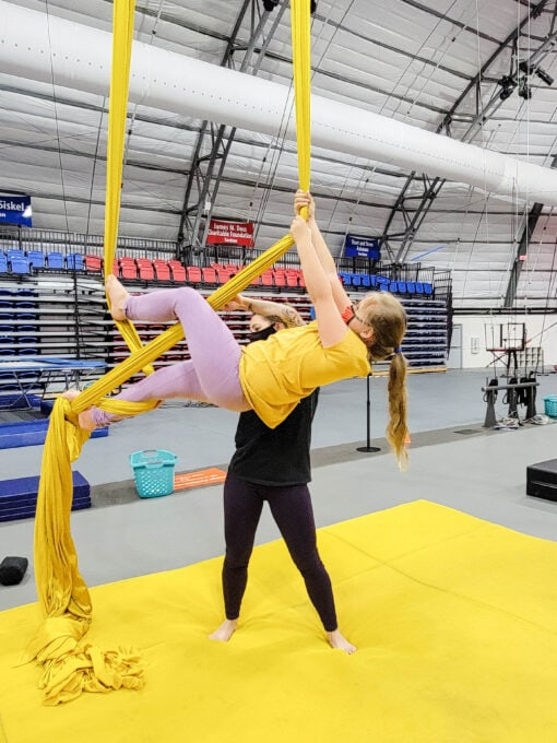 Girl doing tricks on aerial silks at the Circus Arts Conservatory