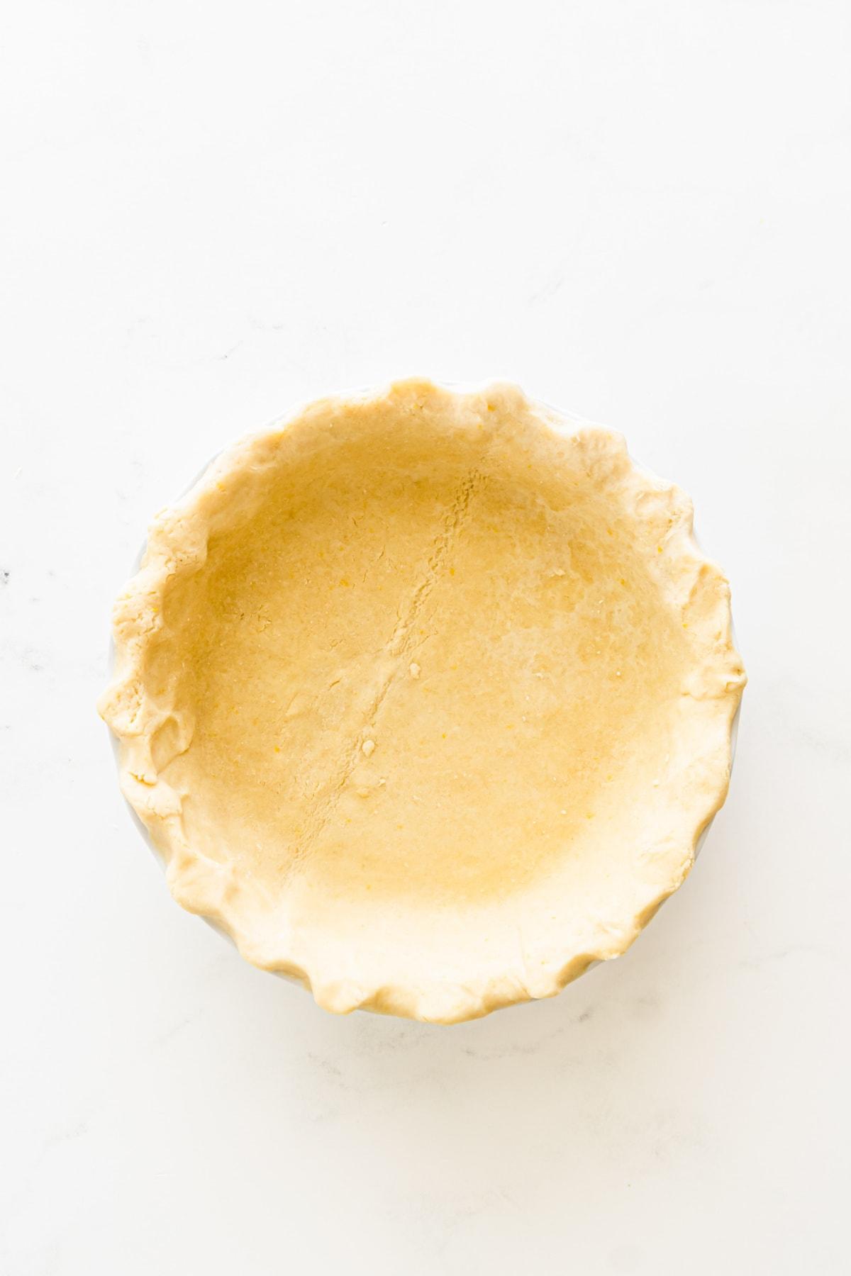 Pie dough in a glass pie pan