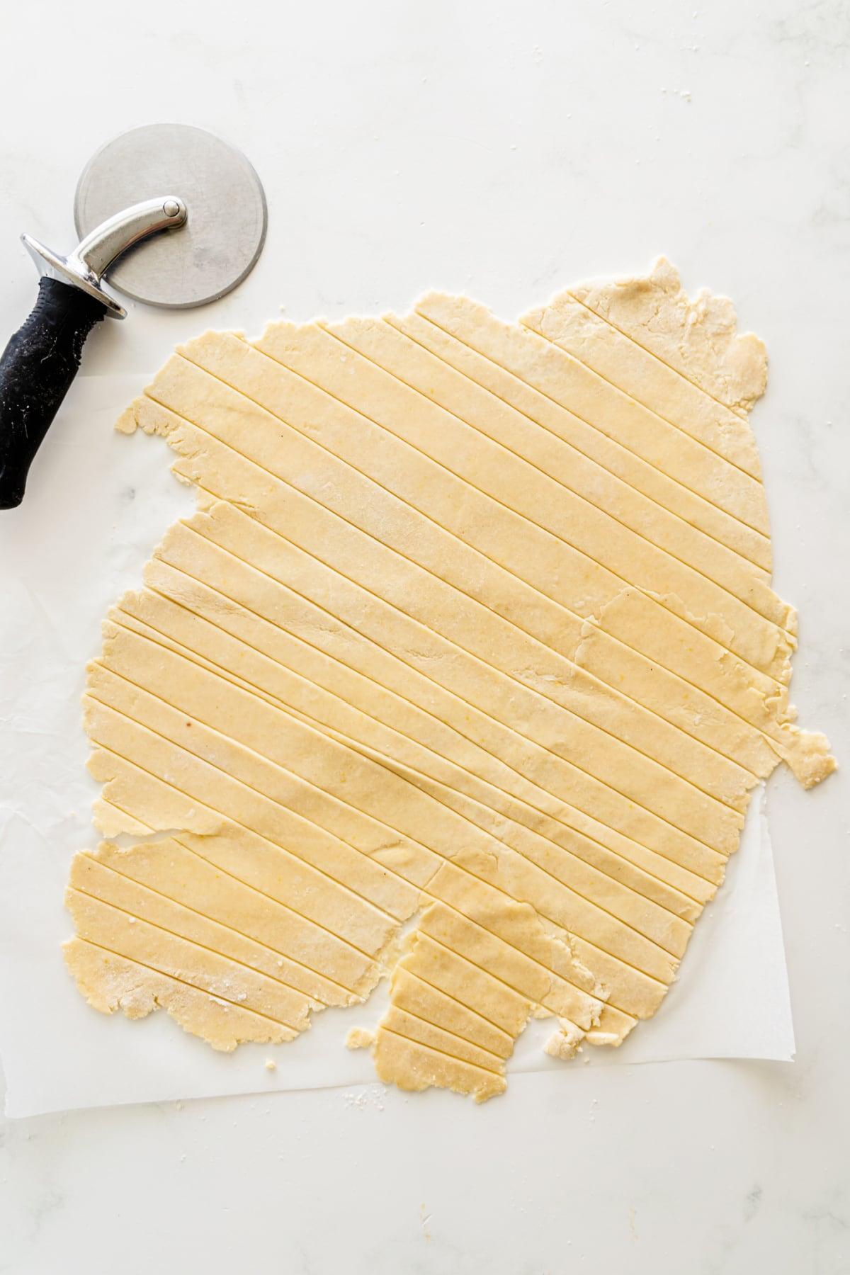 Pie crust dough cut into strips