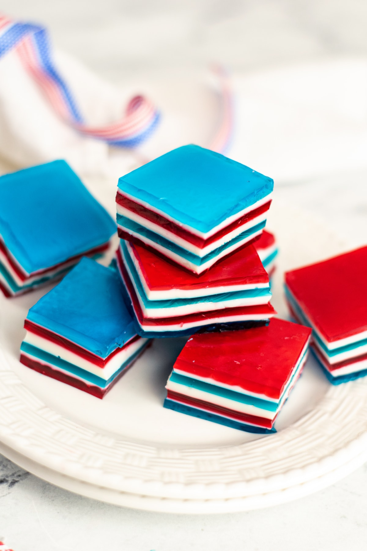 Red, white and blue jello on white plate
