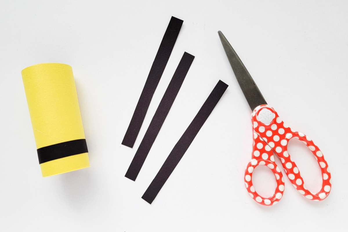 Black construction paper stripes for bumblebee craft