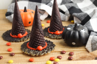 Witch hat cookies with black and white napkin