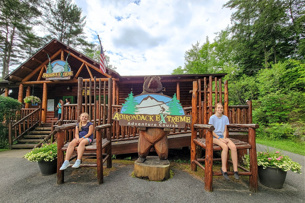 Children sitting in chairs in front of Adirondack Extreme