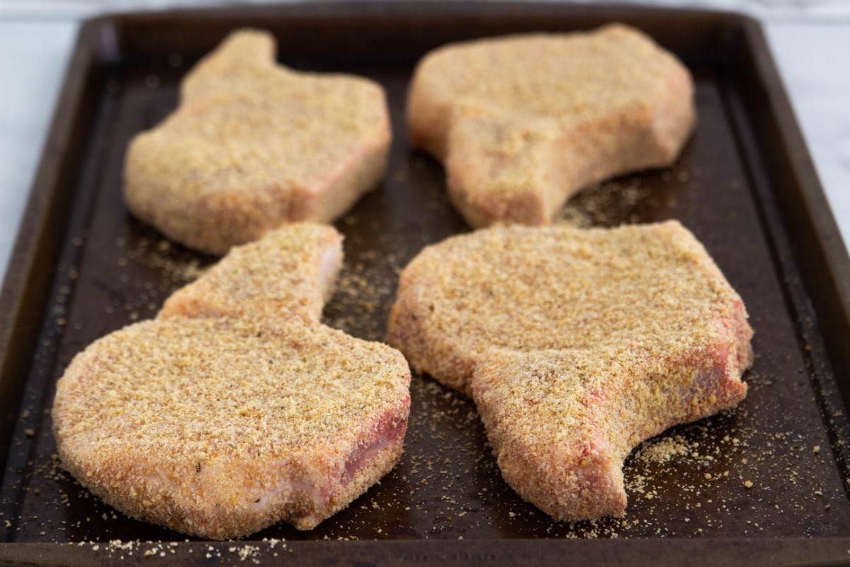 Breaded pork chop on sheet pan