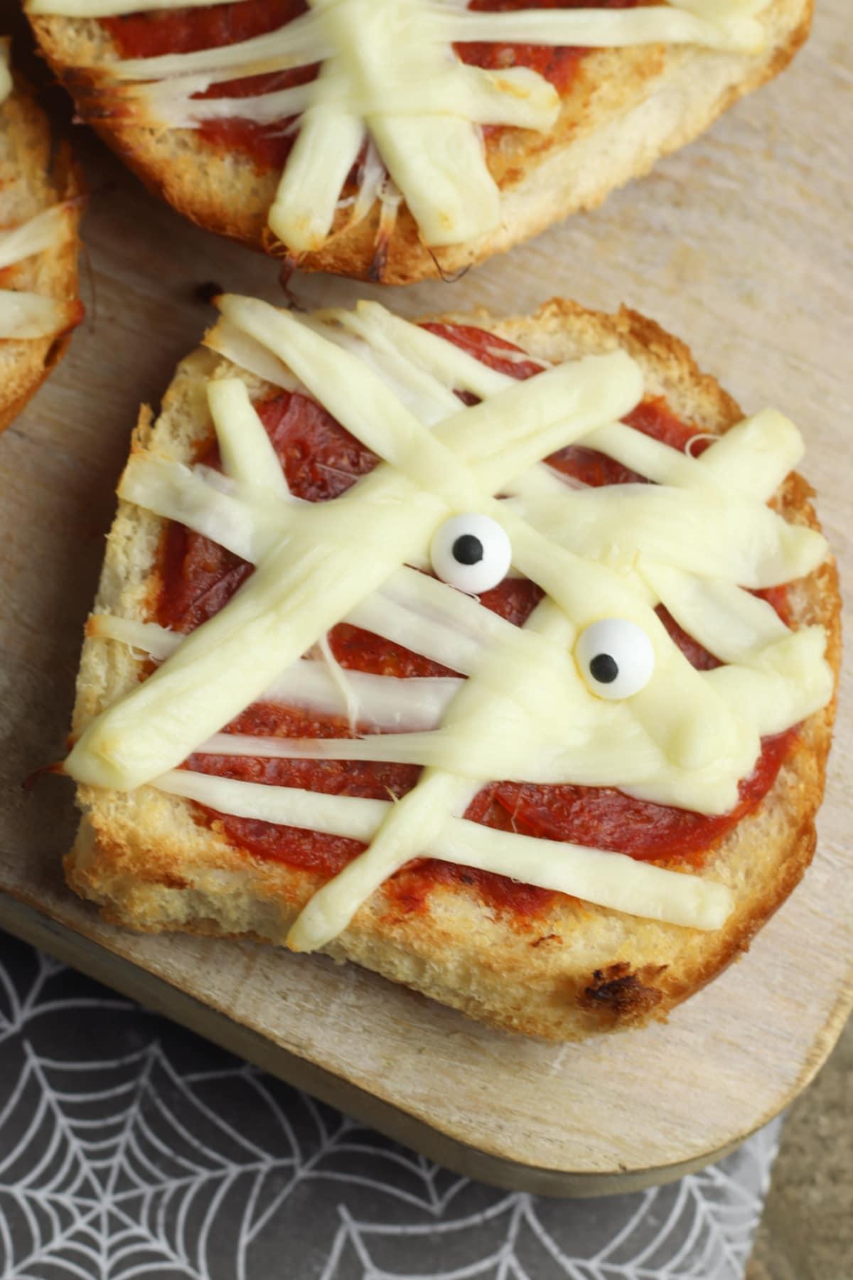 Mummy Pizza on cutting board