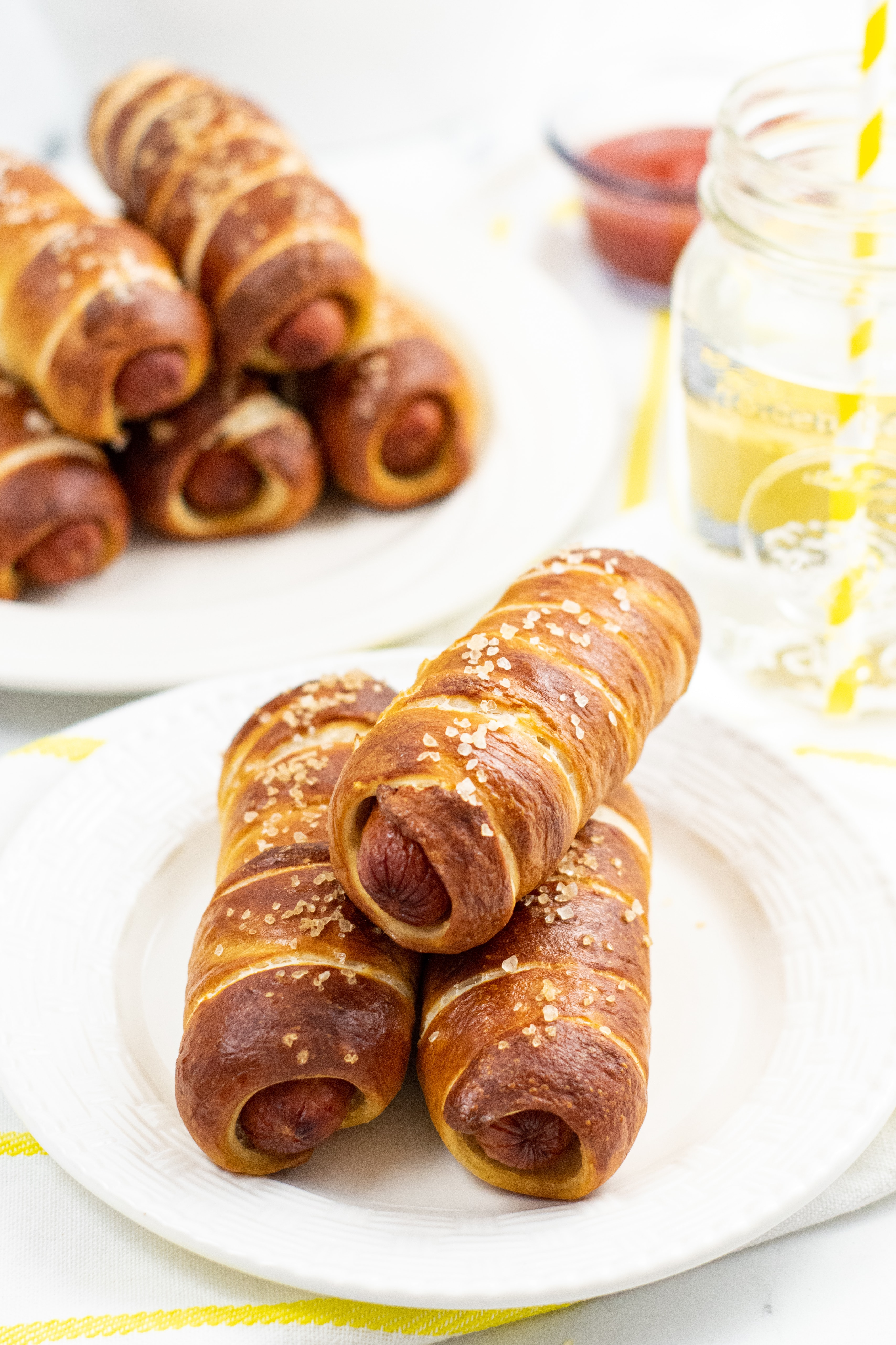 Pretzel dogs on a white plate