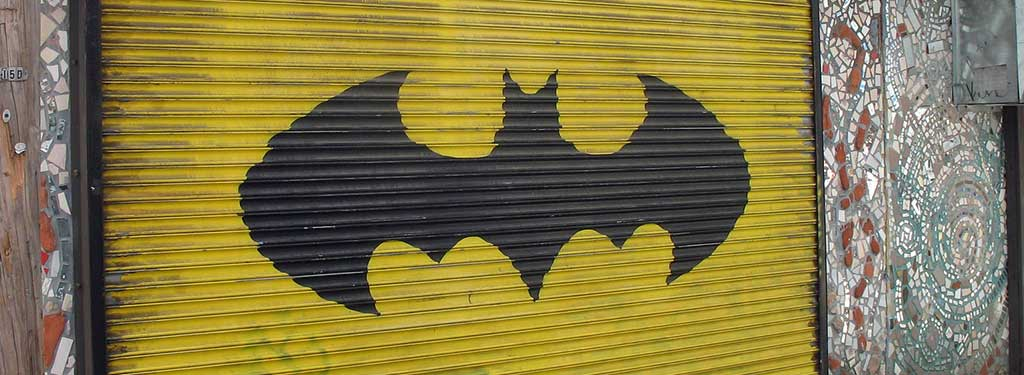 Batman logo on a garage door.