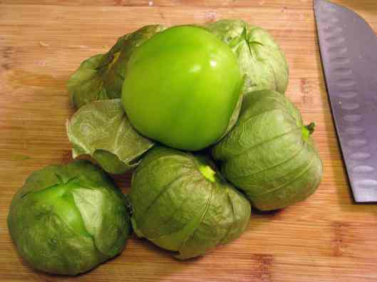 Pile of tomatillos with husks