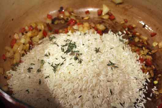 Stir rice and thyme into oil