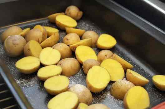 Arrange potatoes in pan with salt